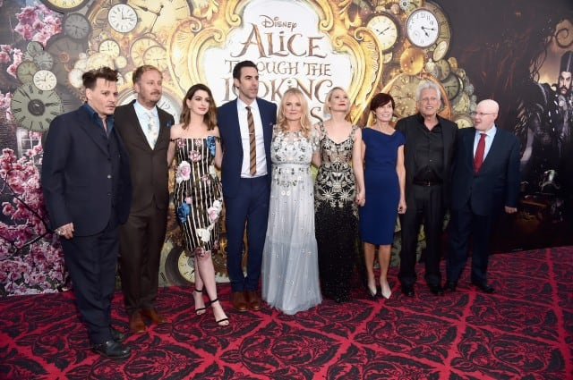 HOLLYWOOD, CA - MAY 23: (L-R) Actor Johnny Depp, director James Bobin, actors Anne Hathaway, Sacha Baron Cohen, producer Suzanne Todd, Mia Wasikowska, screenwriter Linda Wollverton, producer Joe Roth and actor Matt Lucas attend Disneys 'Alice Through the Looking Glass' premiere with the cast of the film, which included Johnny Depp, Anne Hathaway, Mia Wasikowska and Sacha Baron Cohen at the El Capitan Theatre on May 23, 2016 in Hollywood, California. (Photo by Alberto E. Rodriguez/Getty Images for Disney) *** Local Caption *** Johnny Depp; James Bobin; Anne Hathaway; Sacha Baron Cohen; Suzanne Todd; Mia Wasikowska; Linda Wolverton; Joe Roth; Matt Lucas