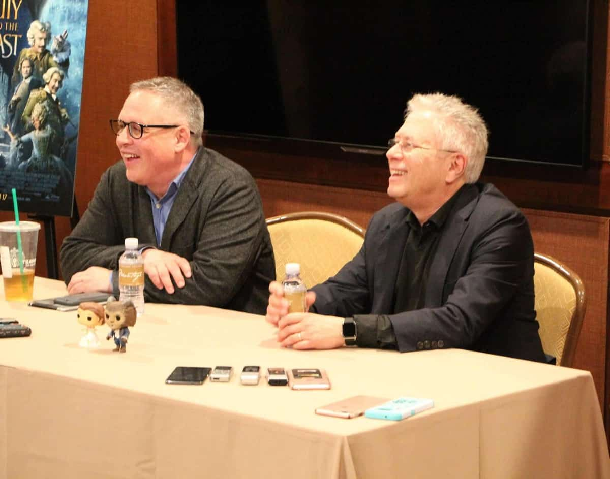 Bill Condon et al. sitting at a table