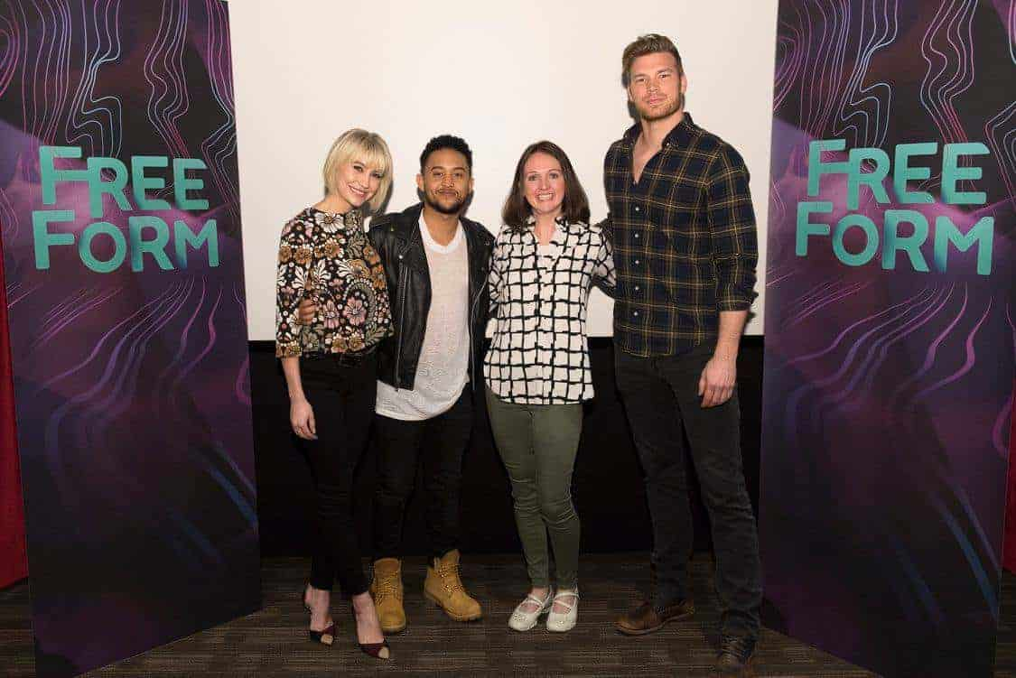 Tahj Mowry, Derek Theler standing around a sign posing for the camera