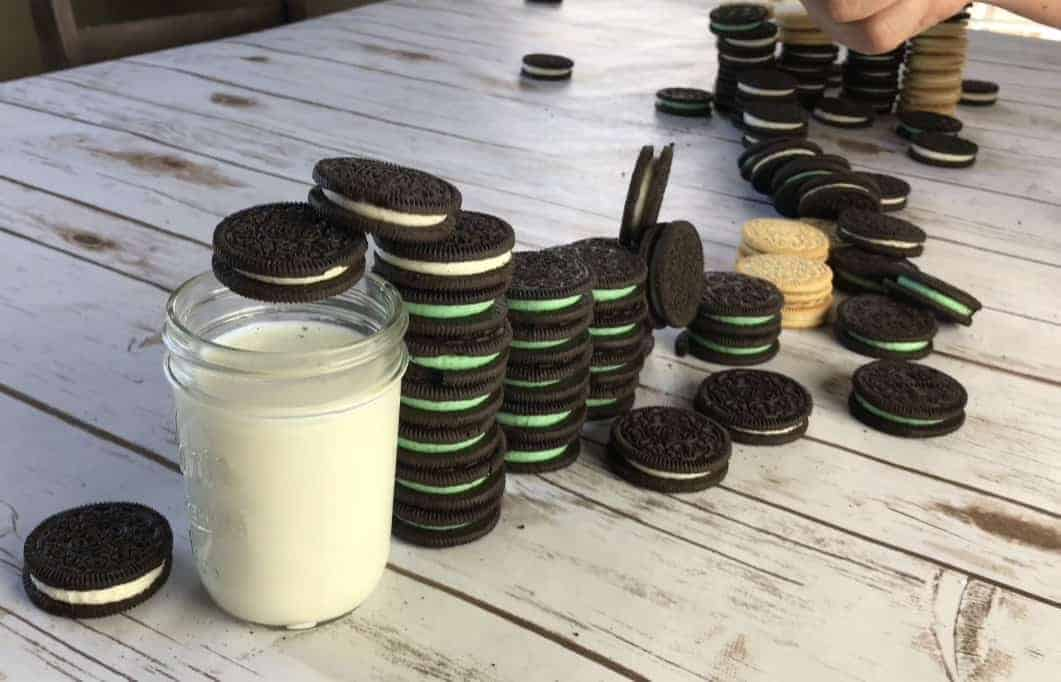 Oreos and milk on a table