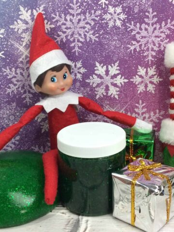 Elf and decorations on a table