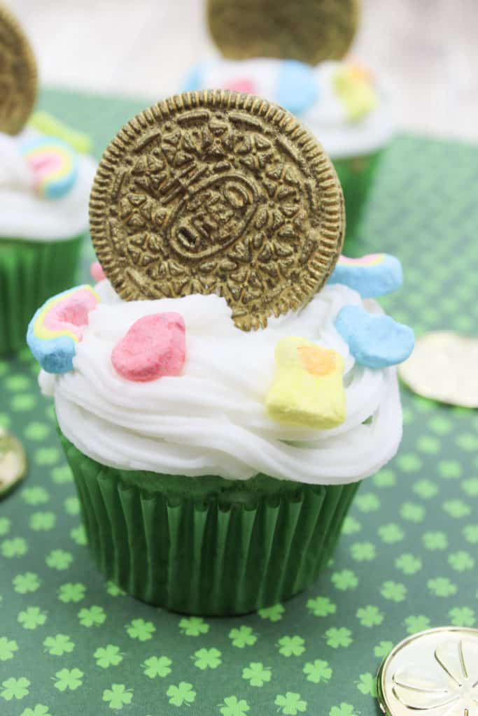 A cake made to look like a cup, with Cookie and Cupcake