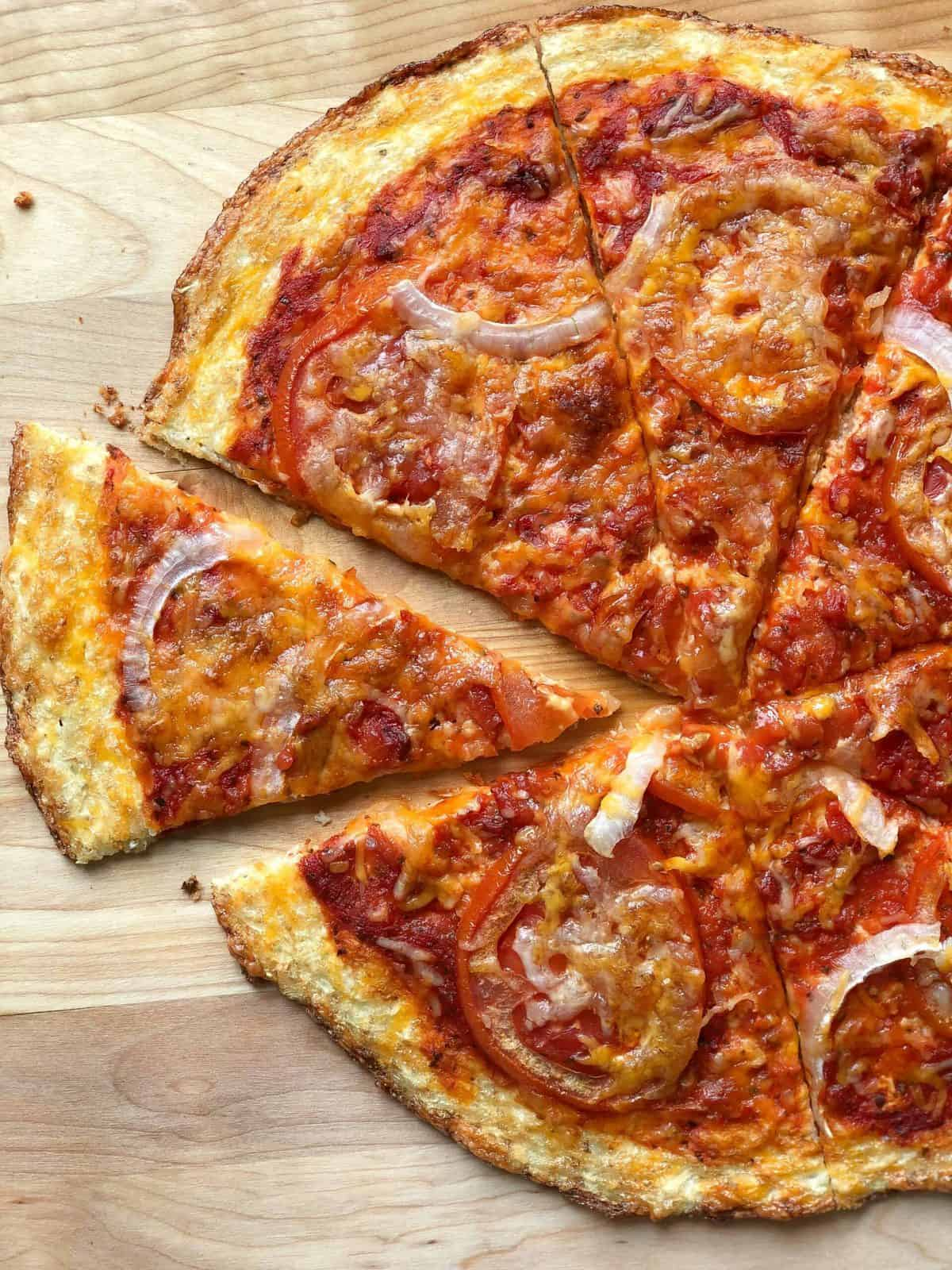 A slice of pizza sitting on top of a wooden cutting board, with Cheese and Crust