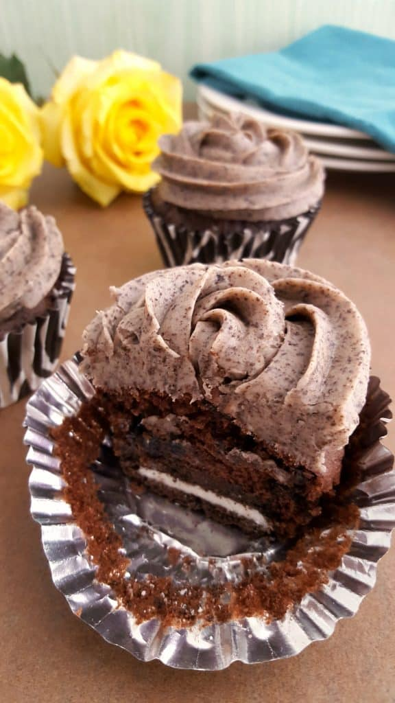 A piece of chocolate cake on a plate, with Cookie and Cupcake