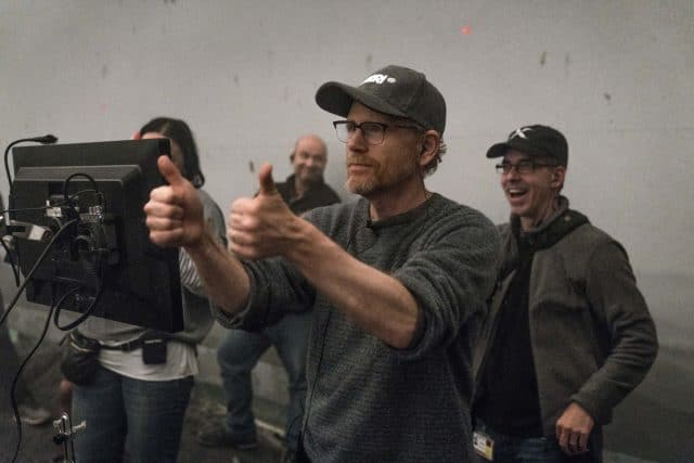 A man standing in front of a mirror posing for the camera, with Ron Howard