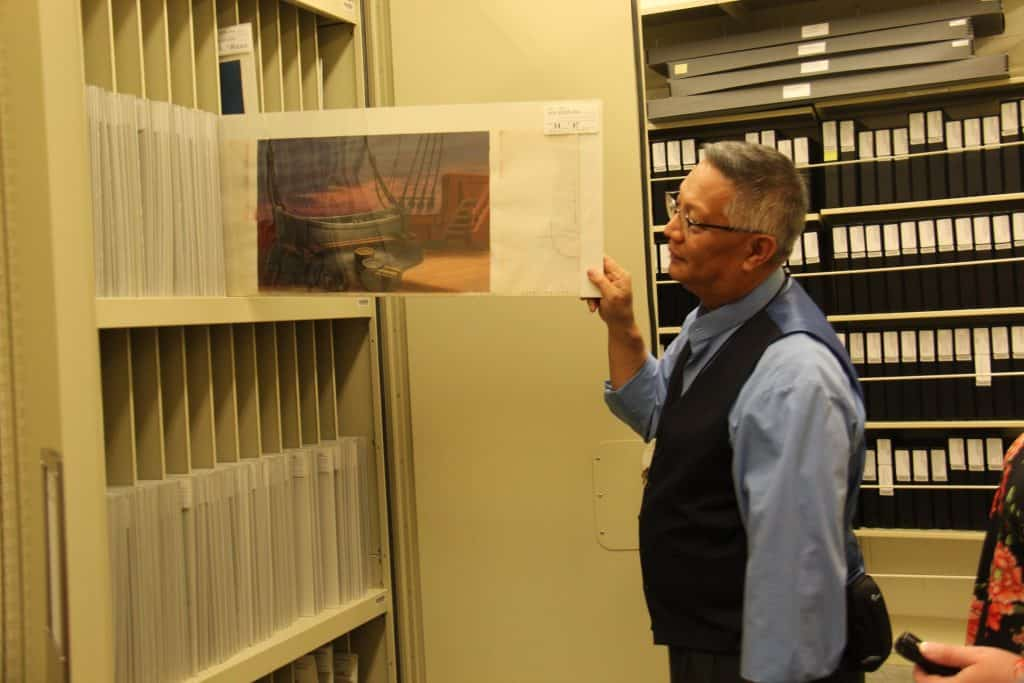 A man standing in a room, with Animation Research Library