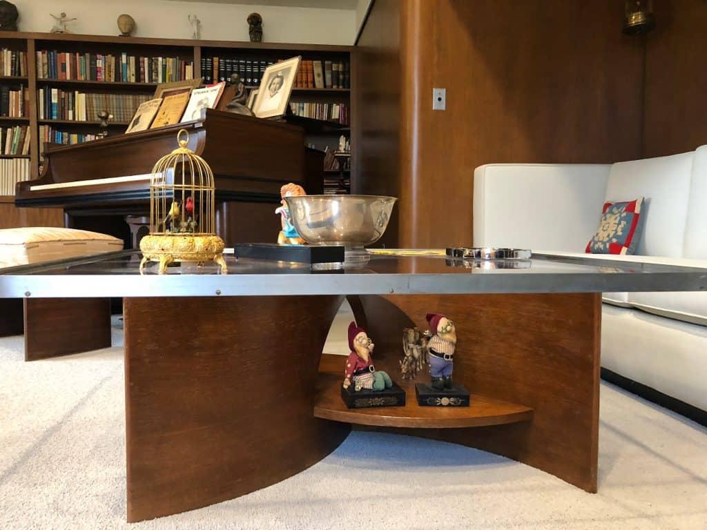 A desk with a book shelf