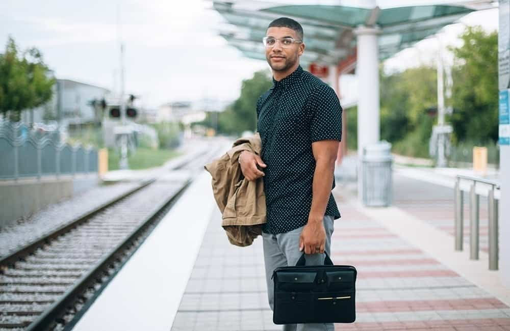 A man carrying a suitcase