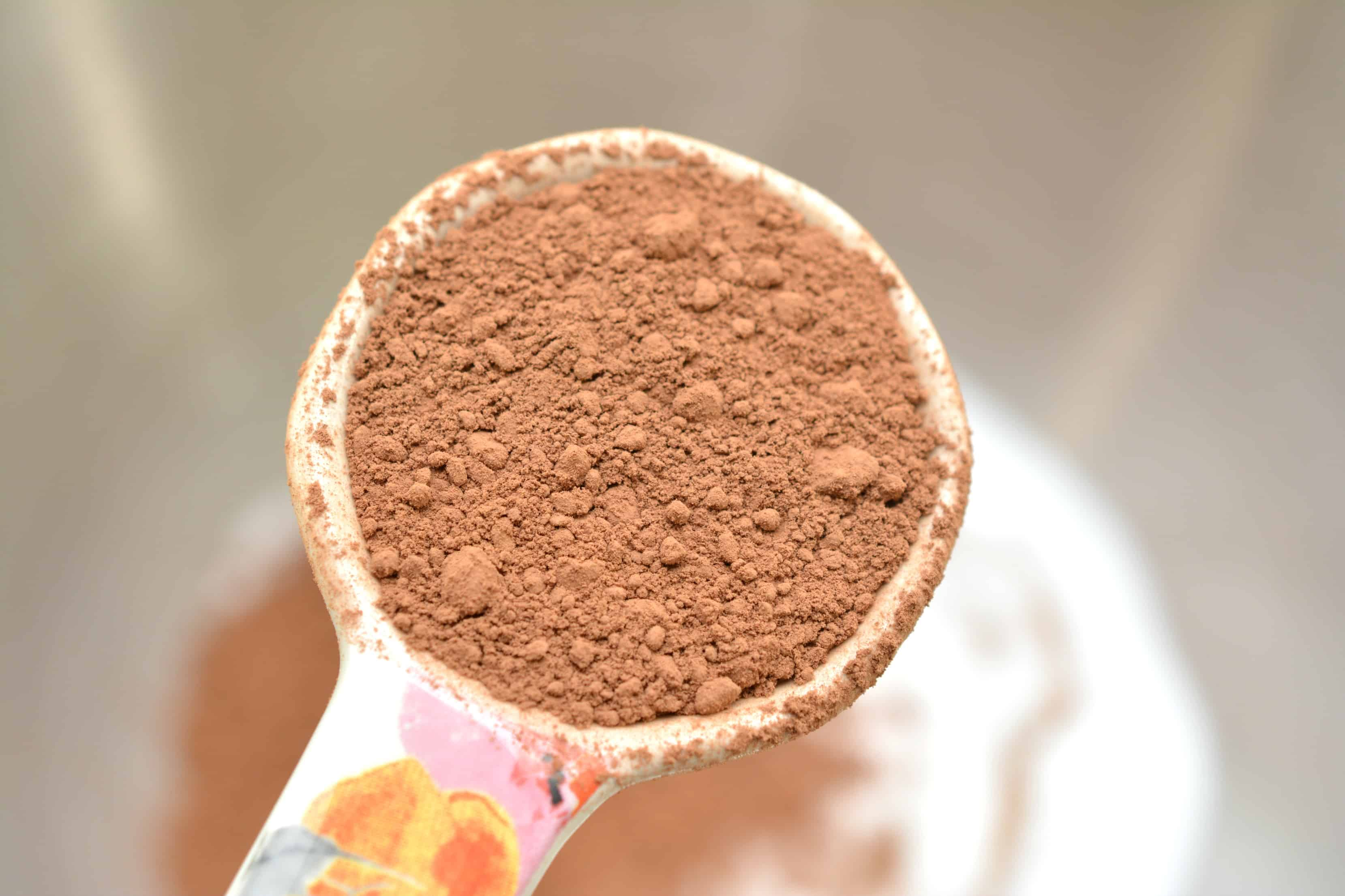 A close up of a person holding a cup of cocoa