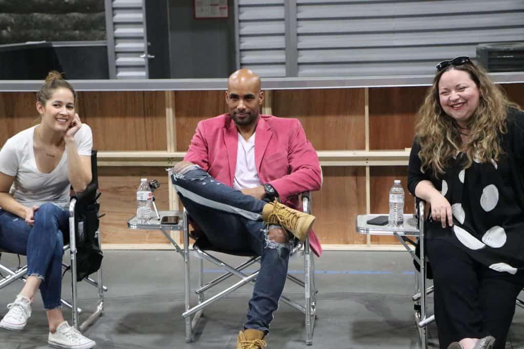 Jaina Lee Ortiz, Boris Kodjoe sitting in chairs