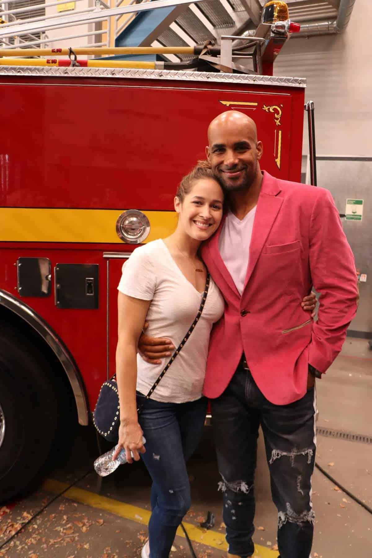 Jaina Lee Ortiz, Boris Kodjoe standing in front of a firetruck