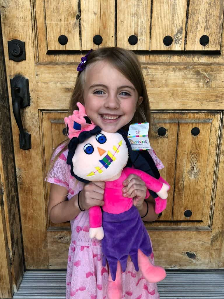 A little girl holding a teddy bear