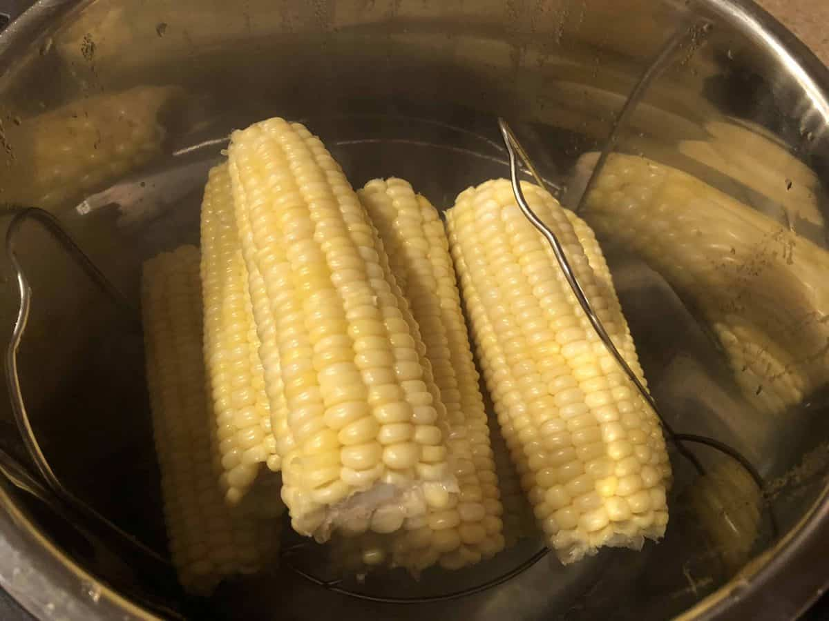A close up of a metal pan filled with corn