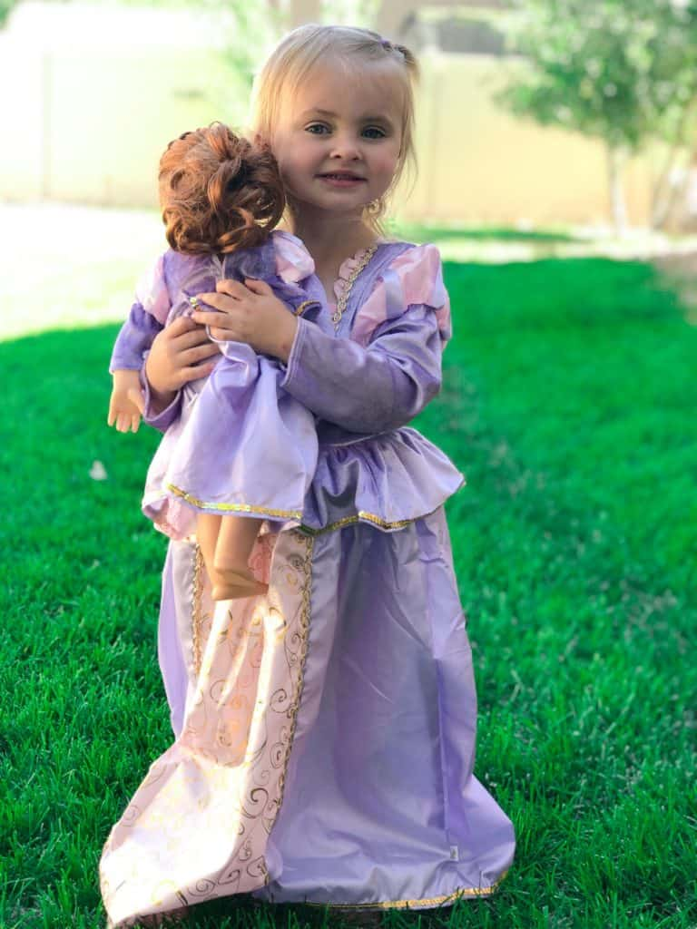 girl holding doll with matching rappel dress