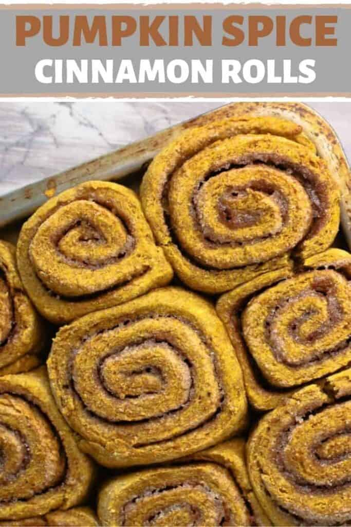 A pan with close up cinnamon rolls on it